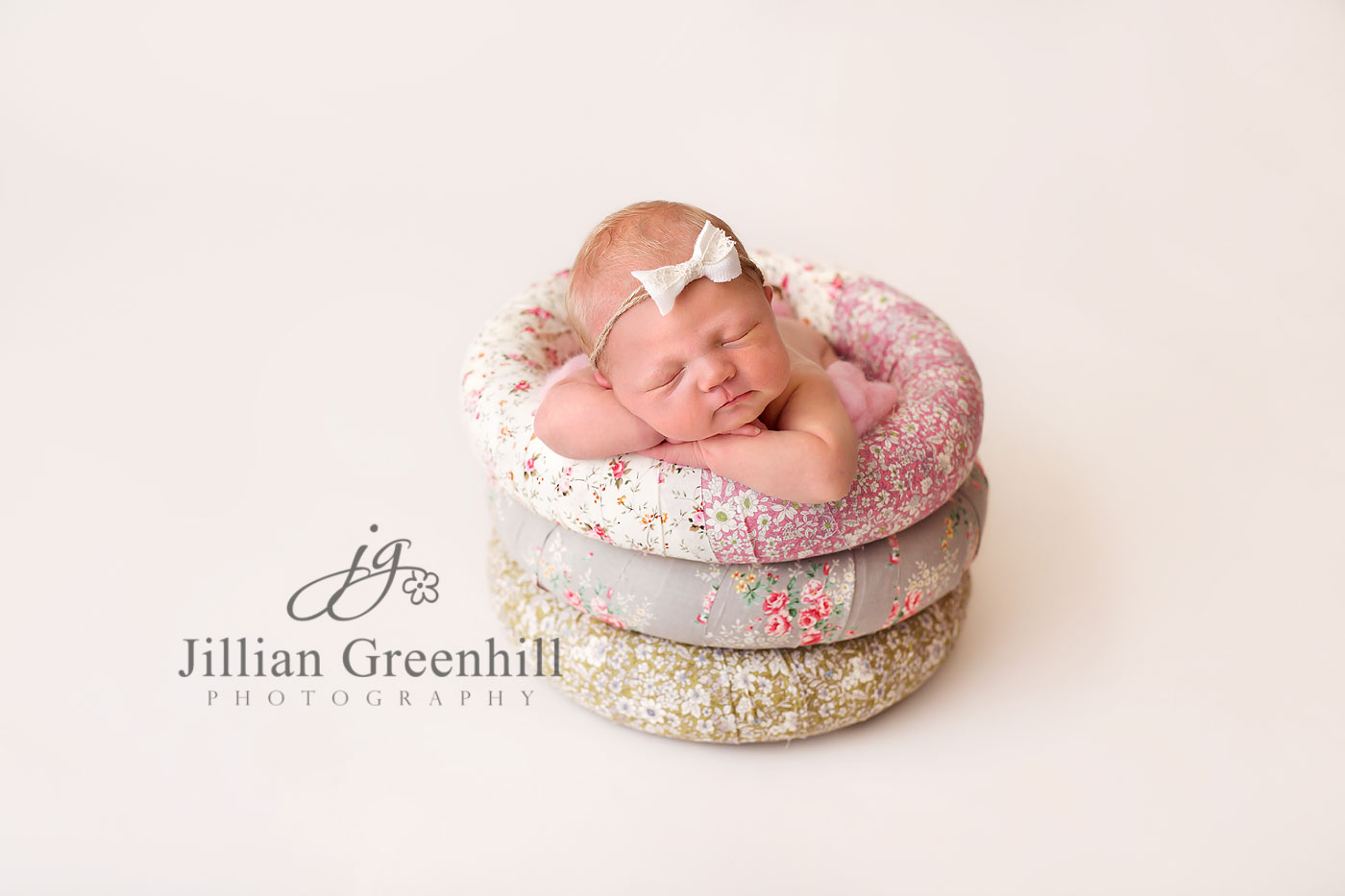 Floral rings newborn baby posing limited